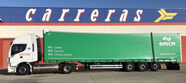 camión con el logo de Saica y fondo con imagen de Carreras